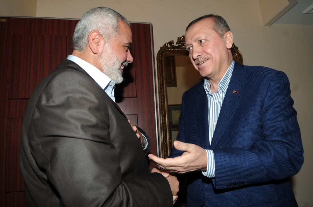 Hamas leader Ismail Haniyeh (L) and Turkish Prime Minister Recep Tayyip Erdogan shaking hands before their meeting at Erdogan's residence in Istanbul Turkey on January 1, 2012. Photo by Mohammed Al-Ostaz / Flash 90