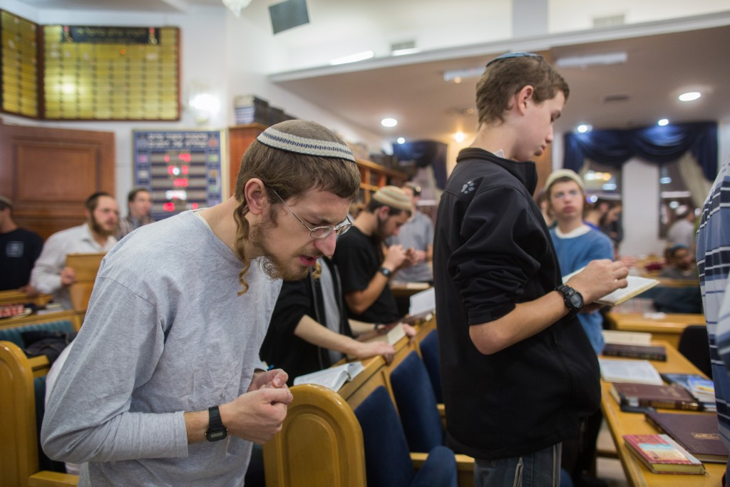 A group says tehillim at the Ayelet Hashachar synagogue in Givat Ze'ev, north of Jerusalem on November 4, 2015, before the demolition of the building. Photo by Yonatan Sindel/Flash90