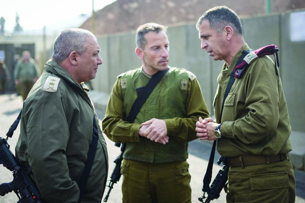 IDF Chief of Staff Gadi Eisenkot (L), with GOC Northern Command Maj.-Gen. Aviv Kochavi (R) and Galil Division Commander Brig.-Gen. Amir Baram, during a tour of the Syrian border on Wednesday. (IDF Spokesman)