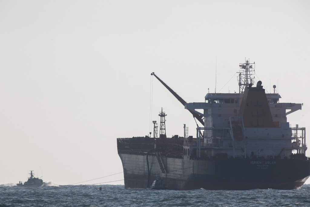 An Israeli naval vessel (L) seen outside the port of Ashdod. Photo by Yonatan Sinde/Flash90
