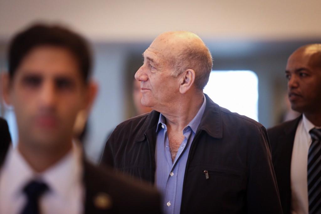 Former Prime Minister Ehud Olmert arrives at the Jerusalem Supreme Court on December 29, 2015. Photo by Noam Moskowitz/POOL