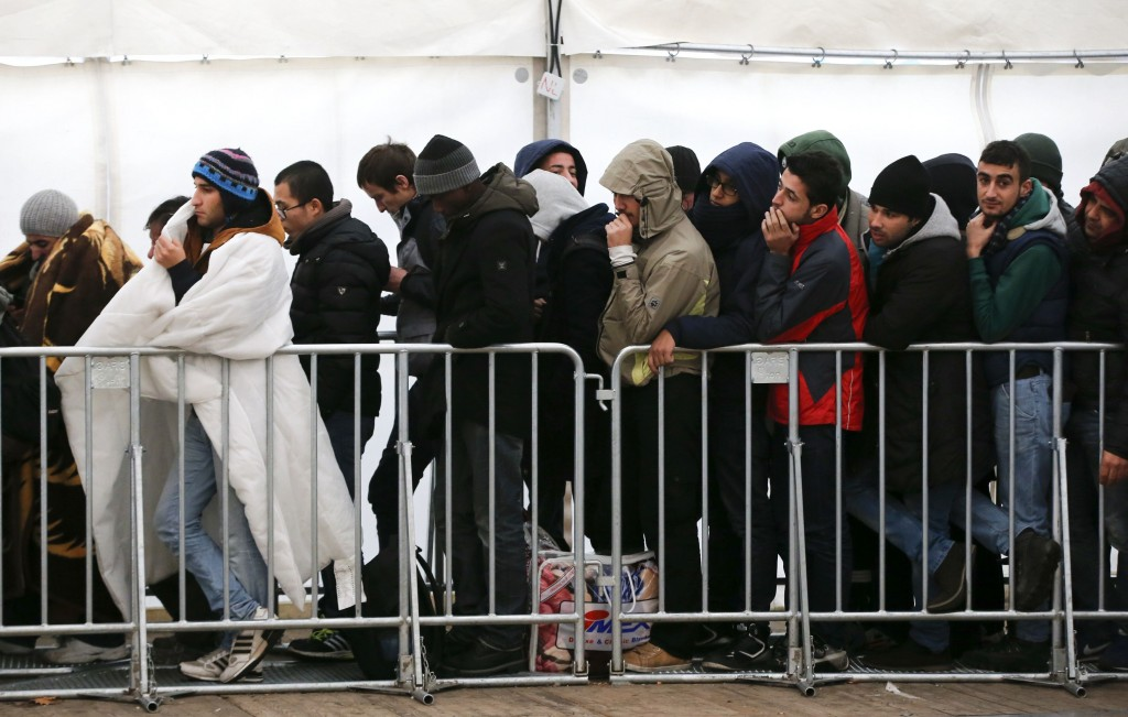 Migrants queue in a tent outside the Berlin Office of Health and Social Affairs, as they wait to register. (Reuters/Fabrizio Bensch)