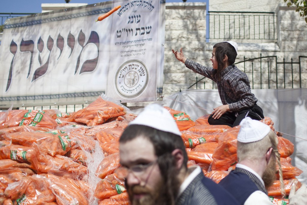 Piles of carrots are seen at a Jerusalem chessed food distribution center before Pesach, April 3, 2012. Photo by Yonatan Sindel / Flash90.