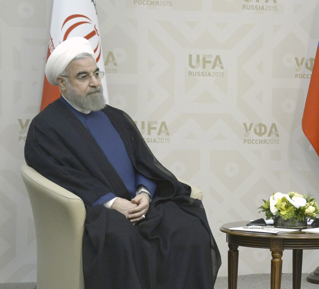 Russian President Vladimir Putin (R) meets with Iran's President Hassan Rouhani in Ufa, Russia, July 9, 2015. Rouhani said on Thursday he was grateful to Russia for its efforts to secure an agreement at talks between six major powers and Iran on Tehran's nuclear program. REUTERS/Alexander Nemenov/Pool (Newscom TagID: rtrlseven170401.jpg) [Photo via Newscom]