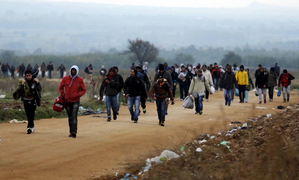 Migrants walk towards a village after entering from Macedonia by foot in Miratovac, Serbia, October 24, 2015. European Commission President Jean-Claude Juncker has called an extraordinary meeting of several European leaders on Sunday to tackle the migrant crisis in the western Balkans as thousands trying to reach Germany are trapped in deteriorating conditions. The Commission said in a statement on Wednesday that Juncker had invited the heads of state or government of Austria, Bulgaria, Croatia, Macedonia, Germany, Greece, Hungary, Romania, Serbia and Slovenia, plus key organisations involved. REUTERS/Ognen Teofilovski (Newscom TagID: rtrlseven404649.jpg) [Photo via Newscom]