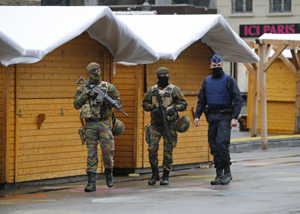 """Belgian soldiers and a police officer patrol in central Brussels, November 21, 2015, after security was tightened in Belgium following the fatal attacks in Paris. Belgium raised the alert status for its capital Brussels to the highest level on Saturday, shutting the metro and warning the public to avoid crowds because of a """"serious and imminent"""" threat of an attack. REUTERS/Youssef Boudlal TPX IMAGES OF THE DAY (Newscom TagID: rtrlseven468194.jpg) [Photo via Newscom]"""