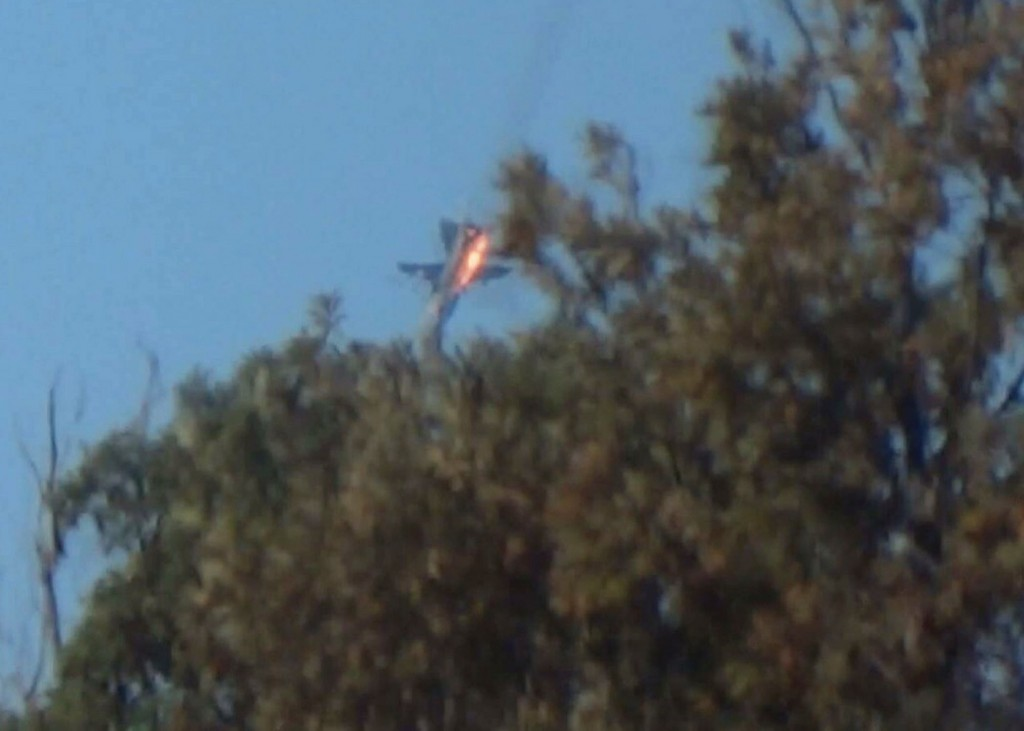 A war plane crashes in flames in a mountainous area in northern Syria after it was shot down by Turkish fighter jets near the Turkish-Syrian border November 24, 2015. Turkish fighter jets shot down a Russian-made warplane near the Syrian border on Tuesday after repeatedly warning it over air space violations, Turkish officials said, but Moscow said it could prove the jet had not left Syrian air space. Turkish presidential sources said the warplane was a Russian-made SU-24. The Turkish military, which did not confirm the plane's origin, said it had been warned 10 times in the space of five minutes about violating Turkish airspace. Russia's defence ministry said one of its fighter jets had been downed in Syria, apparently after coming under fire from the ground, but said it could prove the plane was over Syria for the duration of its flight, Interfax news agency reported. REUTERS/Sadettin Molla ATTENTION EDITORS - FOR EDITORIAL USE ONLY. NOT FOR SALE FOR MARKETING OR ADVERTISING CAMPAIGNS. NO RESALES. NO ARCHIVE TPX IMAGES OF THE DAY (Newscom TagID: rtrlseven473031.jpg) [Photo via Newscom]