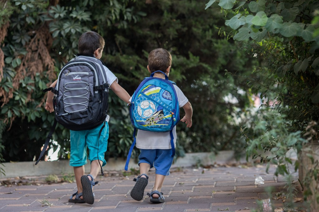 sraeli kids wearing school bags for first day of school and kindergarten outside thier home in Jerusalem on August 31, 2015, The Israeli secular state education system will open tomorrow on September 1, 2015, the academic year with more than two million Israeli children. Photo by Yonatan Sindel/Flash90