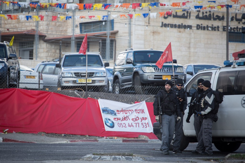 Israeli security forces block the entrance to the Shuafat neighborhood during a police operation to demolish the house of a terrorist who killed two Israelis in an attack last year. December 2, 2015. Photo by Hadas Parush/Flash90