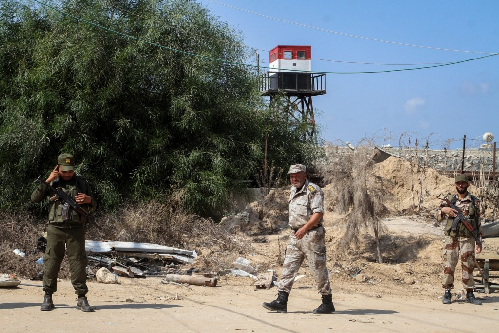 Hamas terrorists next to an Egyptian watch tower on the border between Egypt and Gaza, in Rafiach, southern Gaza Strip. Photo by Abed Rahim Khatib/ Flash90