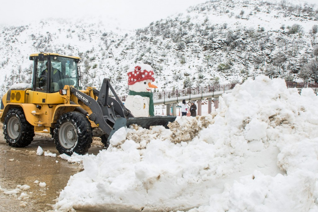 A tractor removes snow from a road at the snowcovered Mt Hermon, in Northern Israel on April 12, 2015. Photo by Basal Awidat/Flash90