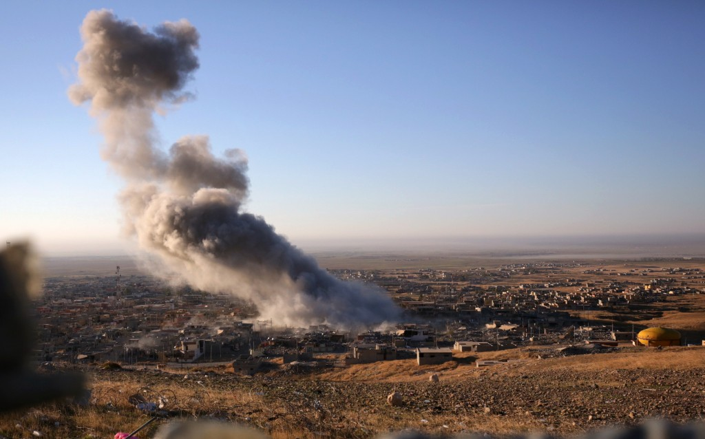 Smoke rises from Islamic State positions following a U.S.-led coalition airstrike in Ramadi, Tuesday. (AP Photo/Bram Janssen, File)