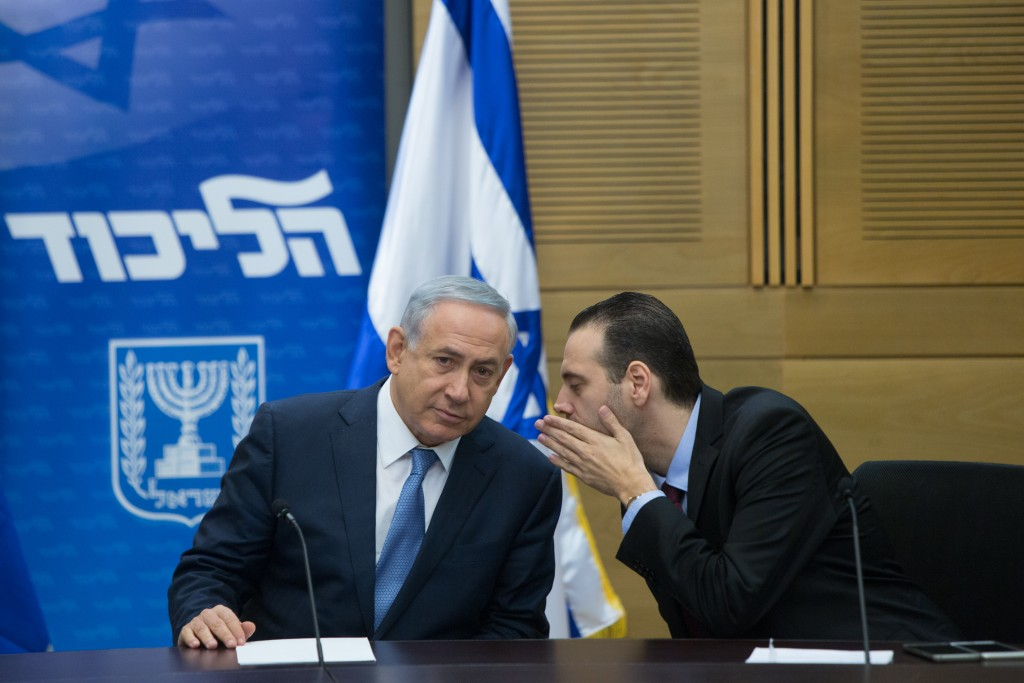 Prime Minister Binyamin Netanyahu (L) speaks with MK Miki Zohar during a Likud faction meeting at the Knesset, December 7, 2015. Photo by Yonatan Sindel/Flash90