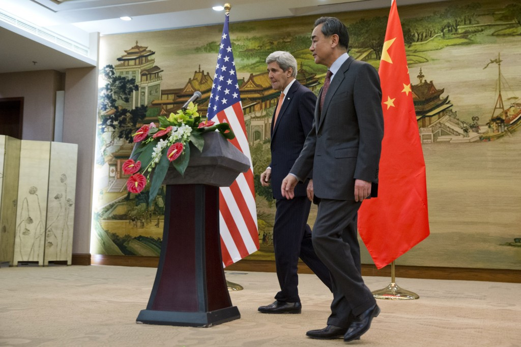U.S. Secretary of State John Kerry leaves a news conference with Chinese Foreign Minister Wang Yi at the Ministry of Foreign Affairs in Beijing on Wednesday. (Reuters/Jacquelyn Martin/Pool)