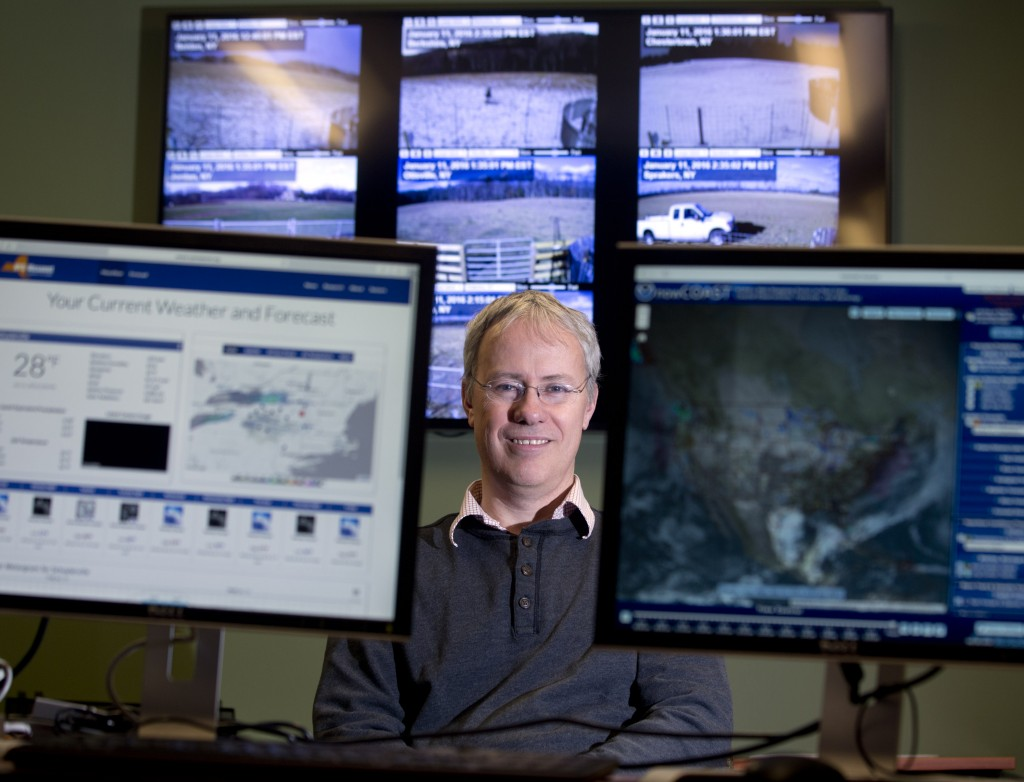 Professor Chris Thorncroft, chairman of the Atmospheric and Environmental Sciences Department at the University at Albany and co- principal investigator for the New York State Mesonet, poses in the Mesonet operations center at the university in Albany, N.Y. (AP Photo/Mike Groll)