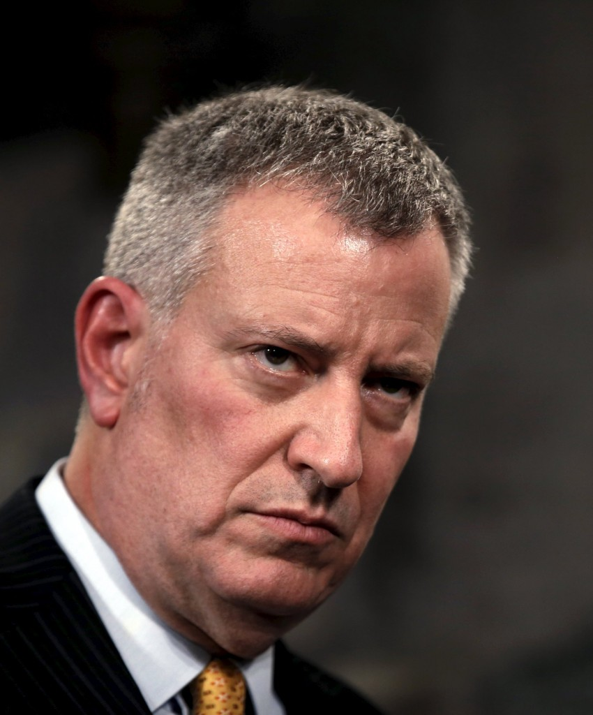 New York City Mayor Bill de Blasio listens to a reporter's question at a recent news conference at City Hall in New York City. (Mike Segar/Reuters)