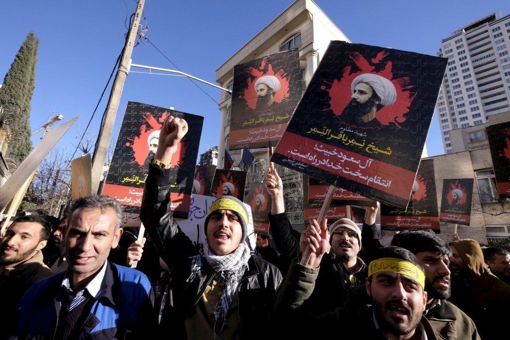 Iranian protesters chant slogans as they hold pictures of Shi'ite cleric Sheikh Nimr al-Nimr during a demonstration against the execution of Nimr in Saudi Arabia, outside the Saudi Arabian Embassy in Tehran. (Raheb Homavandi/TIMA/Reuters)