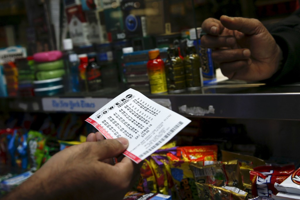 A customer purchases a Powerball ticket in Manhattan. (Reuters/Shannon Stapleton)