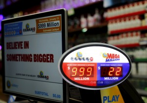 A lotto sign in a store in San Diego, California, on Wednesday. Many lotto signs do not have the ability to post an amount in the billions, and therefore are listing the Powerball prize as $999 million, although the actual estimated jackpot is $1.5 billion. (Reuters/Mike Blake)