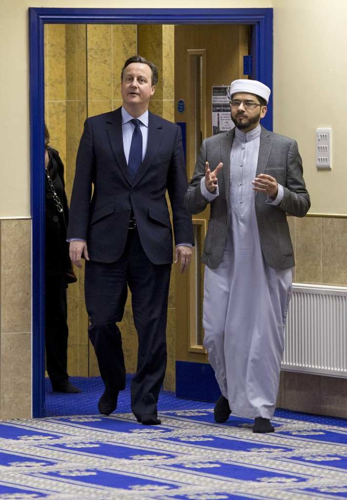 U.K. Prime Minister David Cameron (L) speaks with imam Qari Asim as he visits the Makkah Masjid Mosque in Leeds, Britain, on Monday. (Reuters/Oli Scarff/Pool)