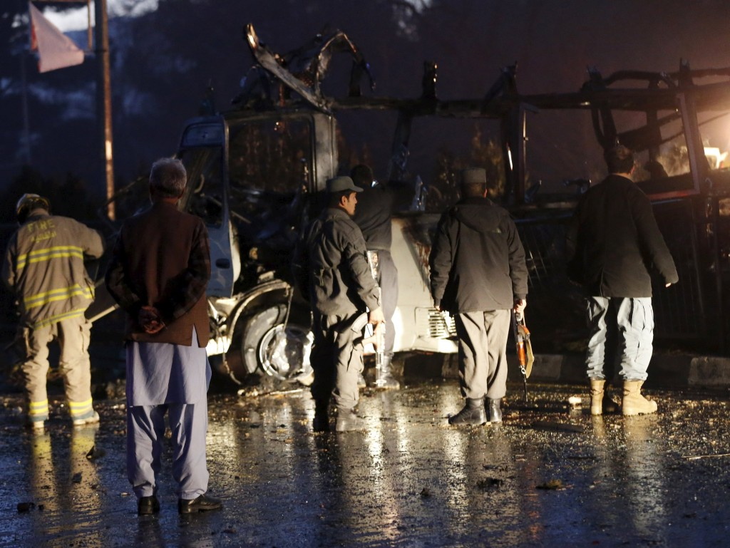 Afghan policemen and fir-fighters inspect the wreckage of a bus that was hit by a suicide bomb attack, in an area near the Russian embassy in Kabul, Afghanistan, on Wednesday. (Reuters/Omar Sobhani)