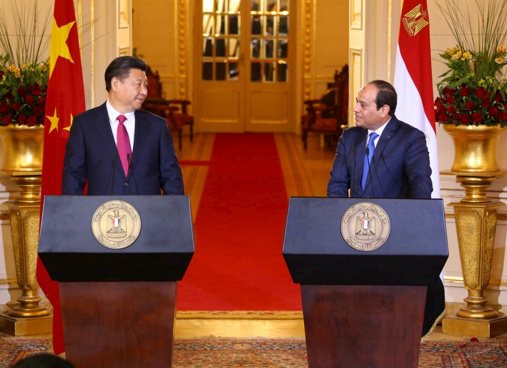 Egyptian President Abdel Fattah al-Sisi (R) and Chinese President Xi Jinping (L) talk during a joint press conference following their meeting in Cairo on Thursday. (The Egyptian Presidency/Handout via Reuters)