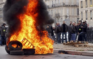 Striking French taxi drivers burn tires in Marseilles during a national protest over competition from private car ride firms like Uber. (Reuters/Jean-Paul Pelissier)