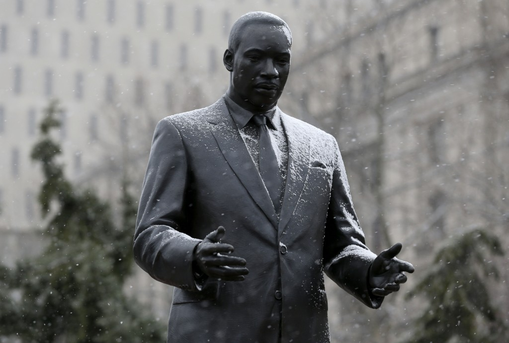 A light snow falls on the statue of Martine Luther King Jr. in Newark, N.J., on Sunday. (AP Photo/Seth Wenig)