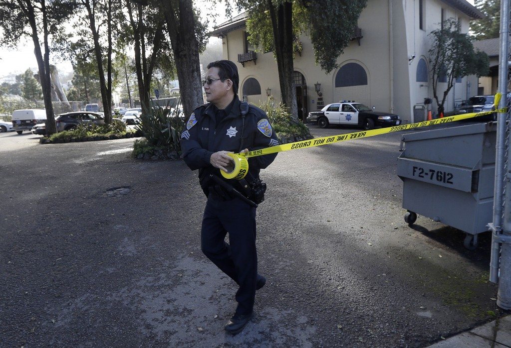 A San Francisco Police puts up yellow tape to block the entrance to Park Police Station in San Francisco, Saturday, Jan. 30, 2016. San Francisco police were responding about Saturday to an unrelated call when a woman said she saw a parked van that looked like the one authorities said the fugitives had stolen, according to Orange County Sheriff Sandra Hutchens. As officers approached, Hossein Nayeri started running and was caught after a short chase. Officers then went back to the van and found Jonathan Tieu hiding, the sheriff said. (AP Photo/Jeff Chiu)