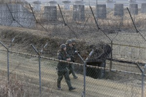 South Korean soldiers patrol the barbed-wire fence in Paju, South Korea, near the border with North Korea, on Wednesday. (AP Photo/Ahn Young-joon)