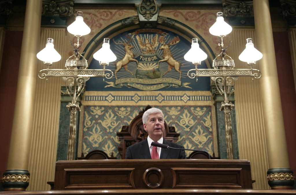 Michigan Gov. Rick Snyder delivers his State of the State address to a joint session of the House and Senate, Tuesday, Jan. 19, 2016, at the state Capitol in Lansing, Mich. With the water crisis gripping Flint threatening to overshadow nearly everything else he has accomplished, the Republican governor pledged a fix Tuesday night during his annual State of the State speech. (AP Photo/Al Goldis)