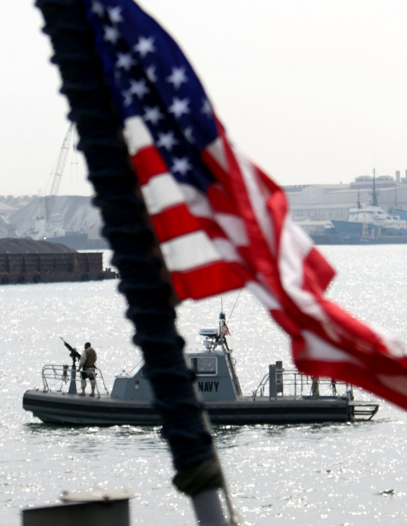 In this file photo, a U.S. Navy boat seen from the deck of a U.S. military ship docked in Manama, Bahrain, patrols the harbor area of the tiny Persian Gulf island nation. (AP Photo/Hasan Jamali)