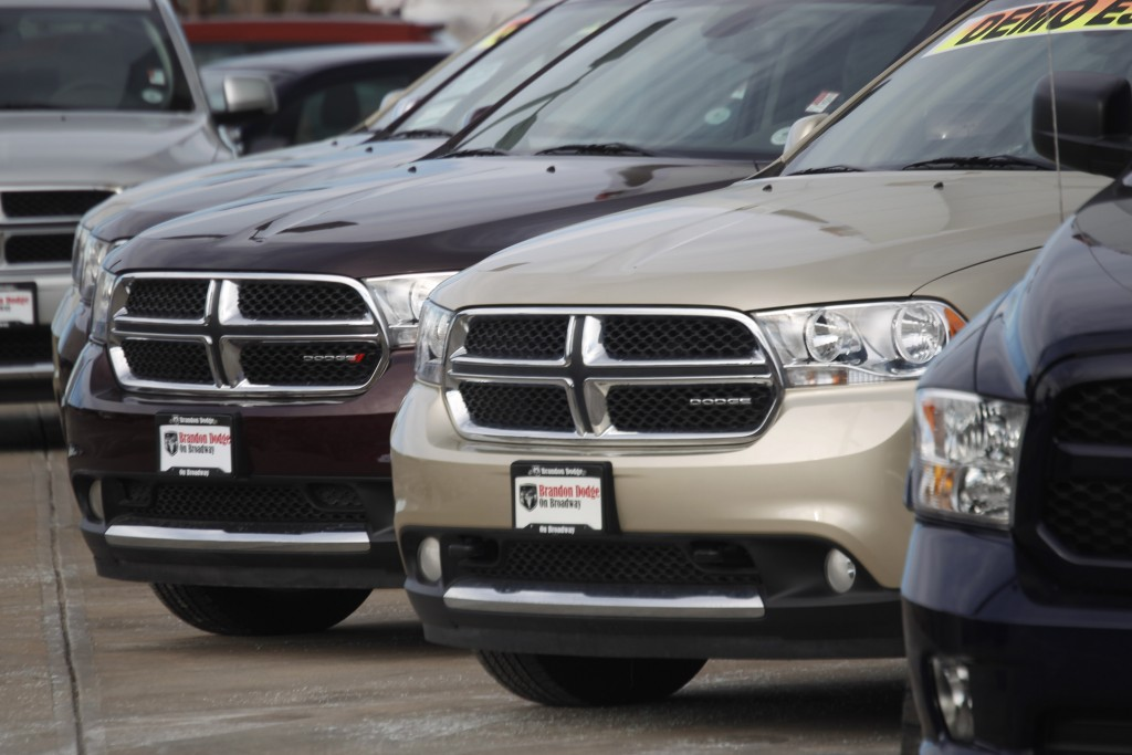 In this Jan. 20, 2013 photo, 2012 Dodge Durango SUV's are seen at a Dodge dealership in Littleton, Colo. (AP Photo/David Zalubowski, File)