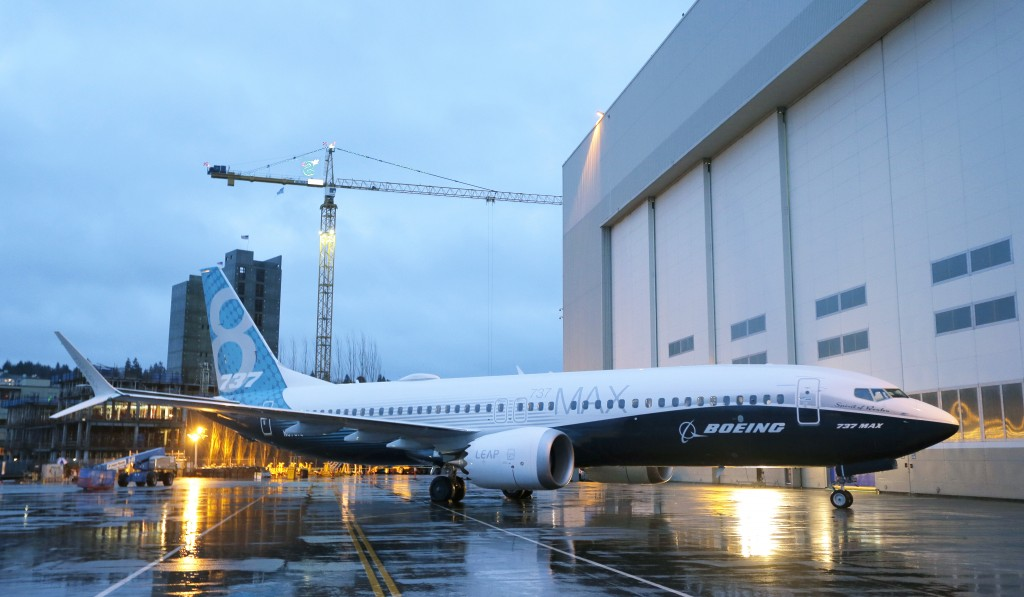 The first Boeing 737 MAX airplane to roll off Boeing's assembly line in Renton, Wash., is shown parked Tuesday, Dec. 8, 2015 before an employee-only rollout event. (AP Photo/Ted S. Warren)