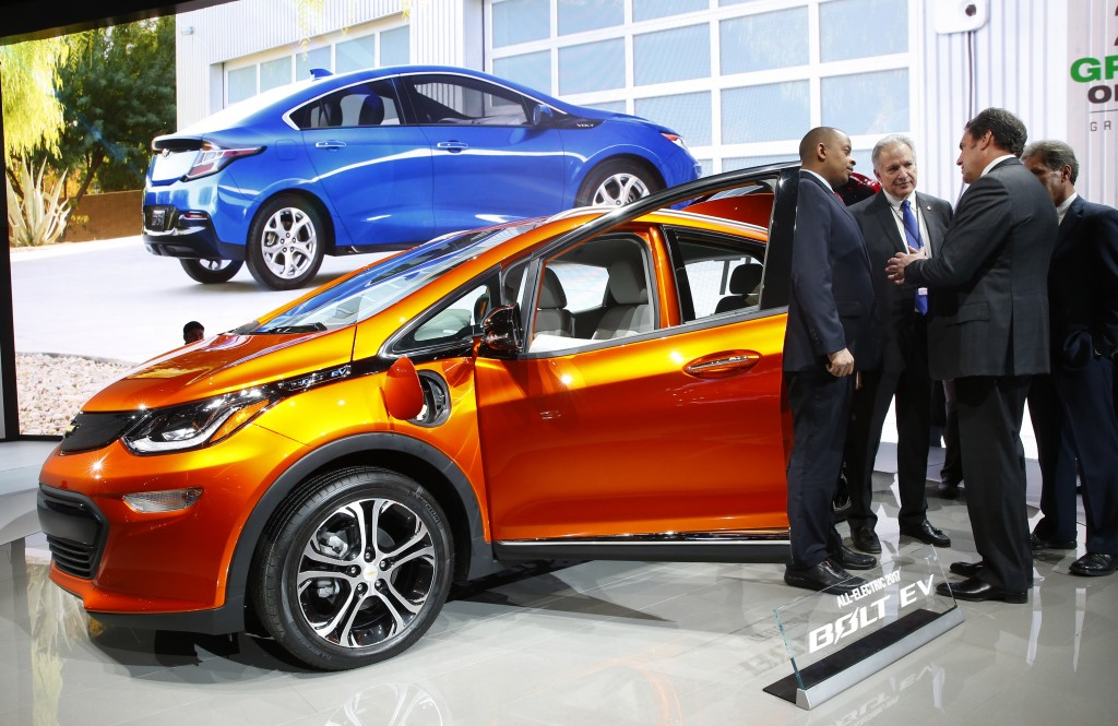 From left, U.S. Transportation Secretary Anthony Foxx and National Highway Traffic Safety Administration Administrator Mark Rosekind listen to Mark Reuss, General Motors Executive Vice President of Global Product Development talk about the 2017 Chevrolet Bolt EV at the North American International Auto Show in Detroit, Thursday, Jan. 14, 2016. Foxx said Thursday that the National Highway Traffic Safety Administration also will develop a model policy for states to follow if they decide to allow autonomous cars on public roads. That policy — which will be developed within six months — could help form the basis of a consistent national policy. (AP Photo/Paul Sancya)