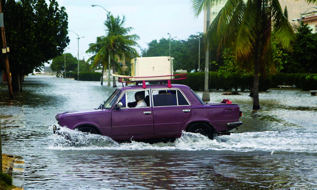 A driver takes a Lada through a flooded portion of Avenida de los Presidentes, in Havana, Cuba, this past weekend. (AP Photo/Desmond Boylan)