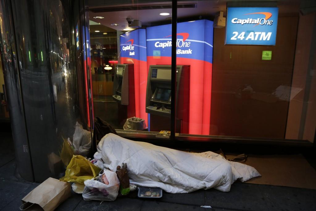 A homeless person sleeping on the streets of New York. (AP Photo/Mark Lennihan)