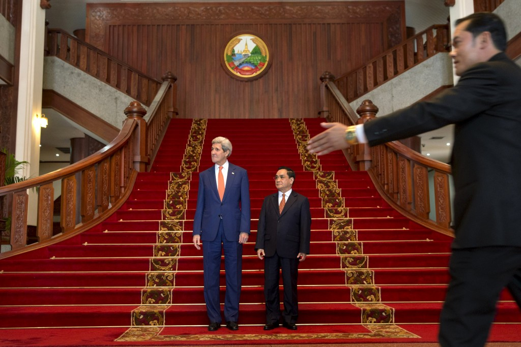 U.S. Secretary of State John Kerry stands with Lao Prime Minister Thongsing Thammavong after their meeting at the Prime Minister's Office in Vientiane, Laos, January 25, 2016. REUTERS/Jacquelyn Martin/Pool