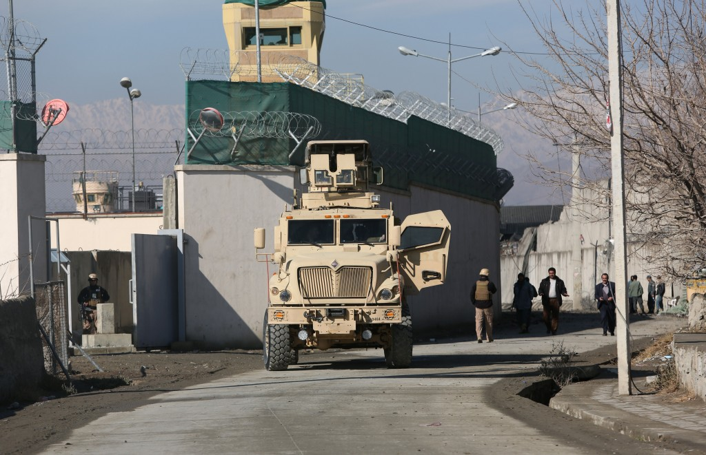 A U.S. military vehicle blocks a road to a logistics company near the site of a deadly suicide attack Monday night in Kabul, Afghanistan, Tuesday, Jan. 5, 2016. The Taliban have claimed responsibility for the attack near the Kabul International Airport which killed several people and wounded at least 36 civilians, including nine women. (AP Photo/Rahmat Gul)