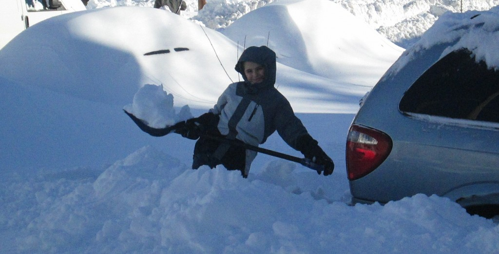 Digging out a car amidst the snow in Baltimore, Sunday. (Hamodia)