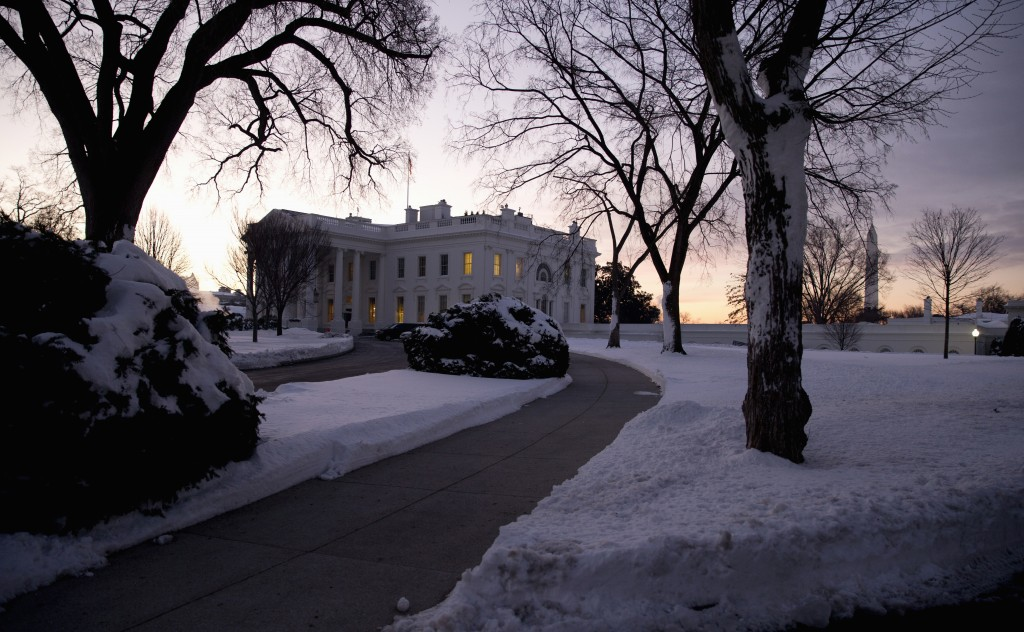 The White House grounds are blanketed in snow in Washington, early Monday, Jan. 25, 2016. East Coast residents who made the most of a paralyzing weekend blizzard face fresh challenges as the workweek begins: slippery roads, spotty transit service mounds of snow, and closed schools and government offices. (AP Photo/Carolyn Kaster)