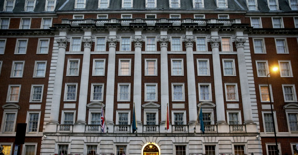 A man stands in front of the Millennium Hotel on Grosvenor Square in London, Thursday, Jan. 21, 2016. British judge Robert Owen is set to release Thursday the findings of a lengthy public inquiry into the 2006 poisoning death of former Russian spy Alexander Litvinenko. One day in 2006, Litvinenko a former KGB agent who claimed to know dark Kremlin secrets had tea with two Russian men at the hotel. Three weeks later, he died of radioactive poisoning — after making a deathbed claim that Russian President Vladimir Putin had ordered his killing. (AP Photo/Matt Dunham)