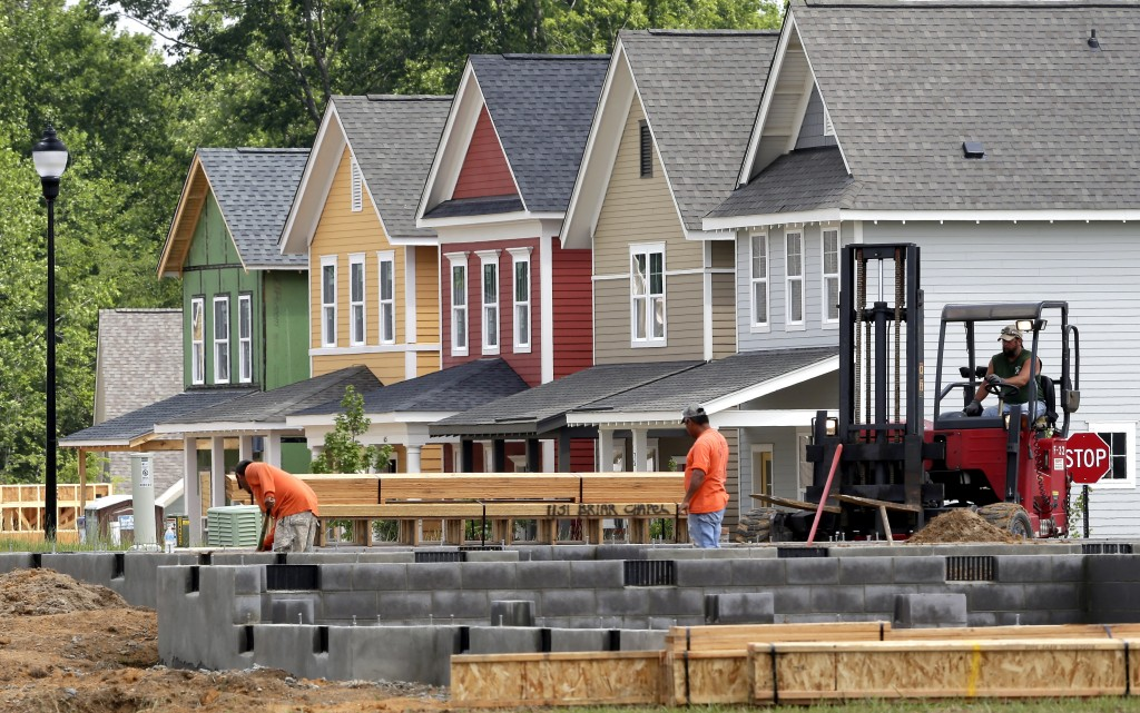 FILE - In this photo June 9, 2015, file photo, builders work on a home under construction in the Briar Chapel community of Chapel Hill, N.C. The National Association of Home Builders/Wells Fargo releases its January 2016 index of builder sentiment on Tuesday, Jan. 19, 2016. (AP Photo/Gerry Broome, File)