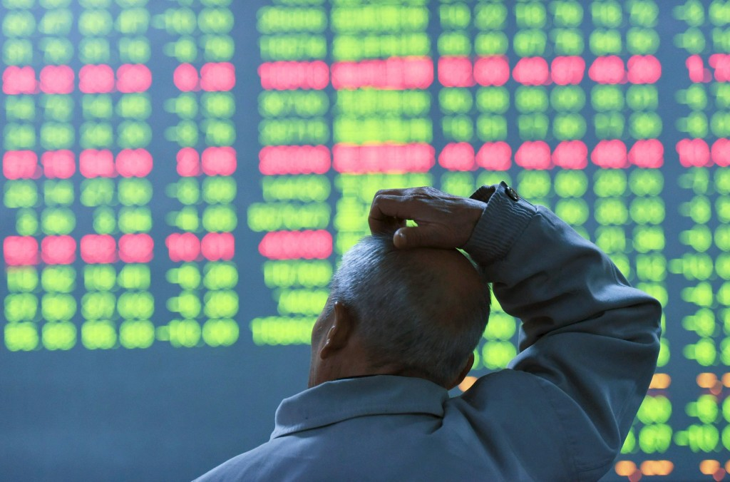 An investor looks at an electronic screen showing stock information at brokerage house in Hangzhou, Zhejiang Province, China, January 11, 2016. China stocks closed down on Monday at their lowest since September, following weak inflation data over the weekend and continuing investor anxiety over the economy and the trajectory of the yuan. REUTERS/China Daily ATTENTION EDITORS - THIS PICTURE WAS PROVIDED BY A THIRD PARTY. THIS PICTURE IS DISTRIBUTED EXACTLY AS RECEIVED BY REUTERS, AS A SERVICE TO CLIENTS. CHINA OUT. NO COMMERCIAL OR EDITORIAL SALES IN CHINA.