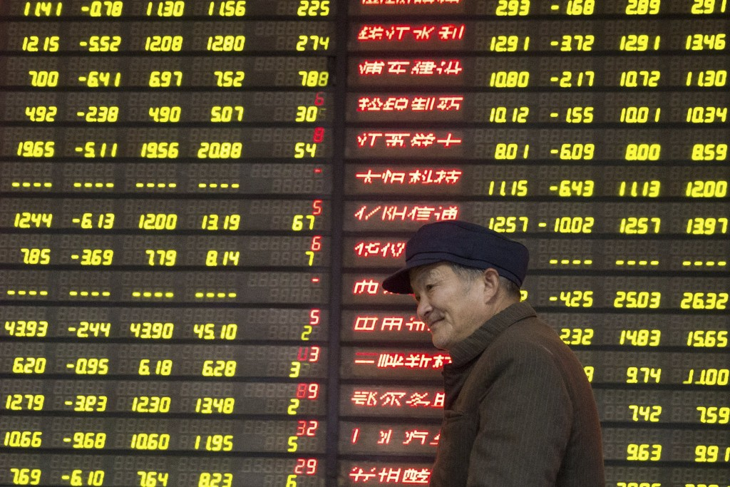An investor walks past an electronic board showing stock information at a brokerage house in Nanjing, Jiangsu province, China, January 13, 2016. REUTERS/China Daily ATTENTION EDITORS - THIS PICTURE WAS PROVIDED BY A THIRD PARTY. THIS PICTURE IS DISTRIBUTED EXACTLY AS RECEIVED BY REUTERS, AS A SERVICE TO CLIENTS. CHINA OUT. NO COMMERCIAL OR EDITORIAL SALES IN CHINA.