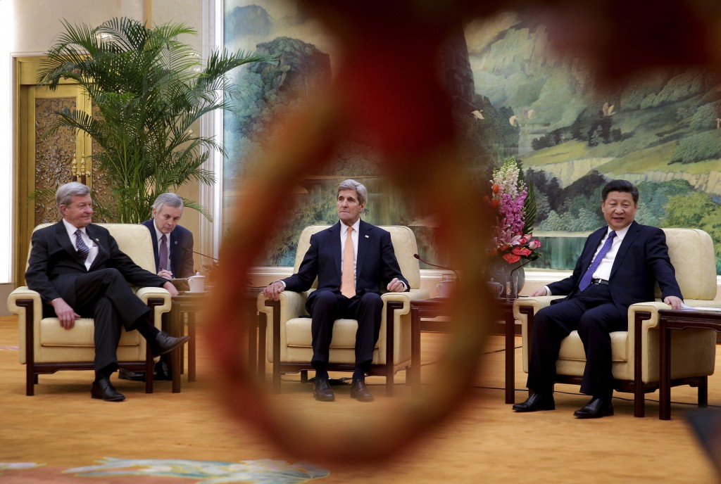 Secretary of State John Kerry, center, is seen through a loop of a rope used as a security line for the media as he and U.S. Ambassador to China Max Baucus, left, meet with Chinese President Xi Jinping at the Great Hall of the People in Beijing, Wednesday, Jan. 27, 2016. REUTERS/Andy Wong/Pool