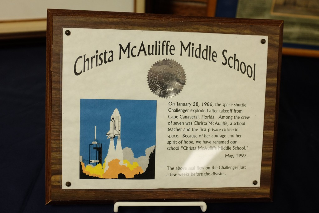 A display in the lobby of Christa McAuliffe Middle School in Bay County's Bangor Township, Mich., honors the teacher-astronaut who died in the Challenger explosion 30 years ago. (Andrew Dodson/The Bay City Times via AP)