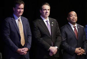 New York Gov. Andrew Cuomo, center, with Senate Majority Leader John Flanagan, left, R-Smithtown, and Assembly Speaker Carl Heastie, D-Bronx, before delivering his State of the State address at the Empire State Plaza Convention Center. (AP Photo/Mike Groll)