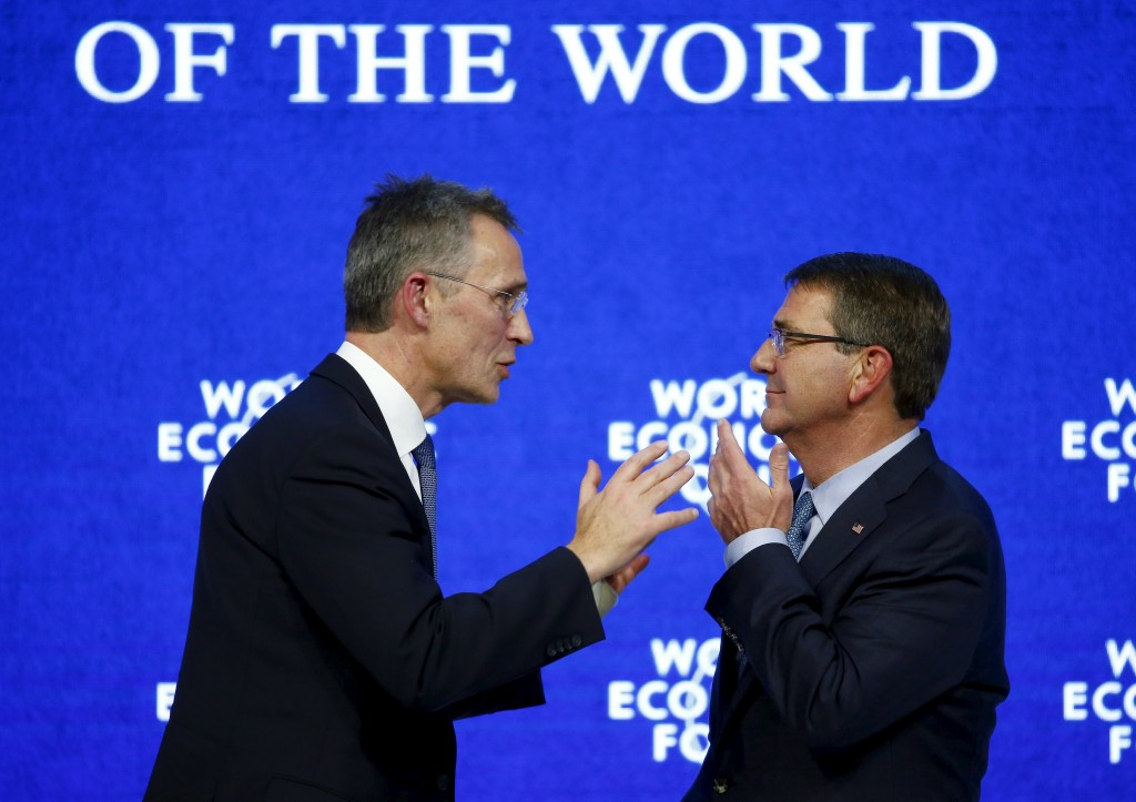 NATO Secretary-General Jens Stoltenberg (L) talks to U.S. Secretary of Defense Ash Carter at the annual meeting of the World Economic Forum (WEF) in Davos, Switzerland January 22, 2016. REUTERS/Ruben Sprich