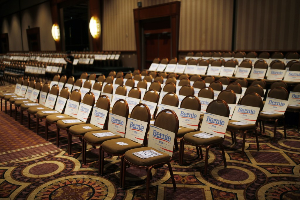 Signs for Democratic presidential candidate Sen. Bernie Sanders, I-Vt., line chairs at the Battle Born Battleground First in the West Caucus Dinner, Wednesday, Jan. 6, 2016, in Las Vegas. (AP Photo/John Locher)